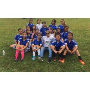 Miss Bhutan USA Bimla with the players