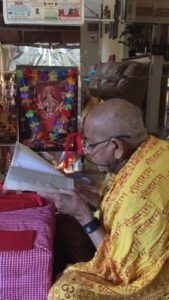 Nepal recites holy book at his residence. Photo: His family